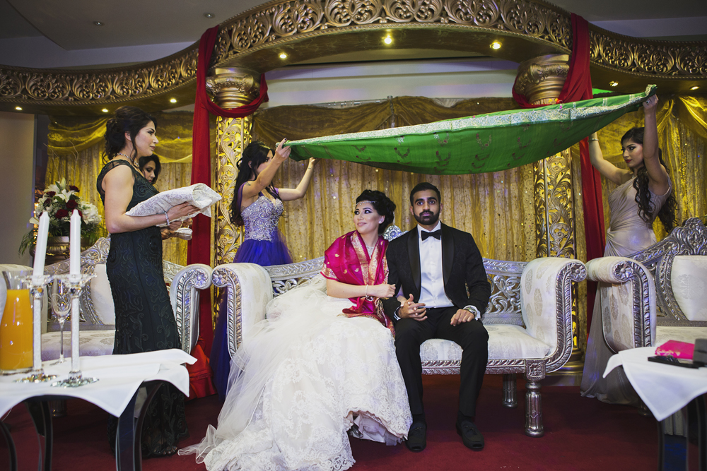 ana gely photography female asian wedding photographer premier banqueting venue stage bride and groom afghan tradition