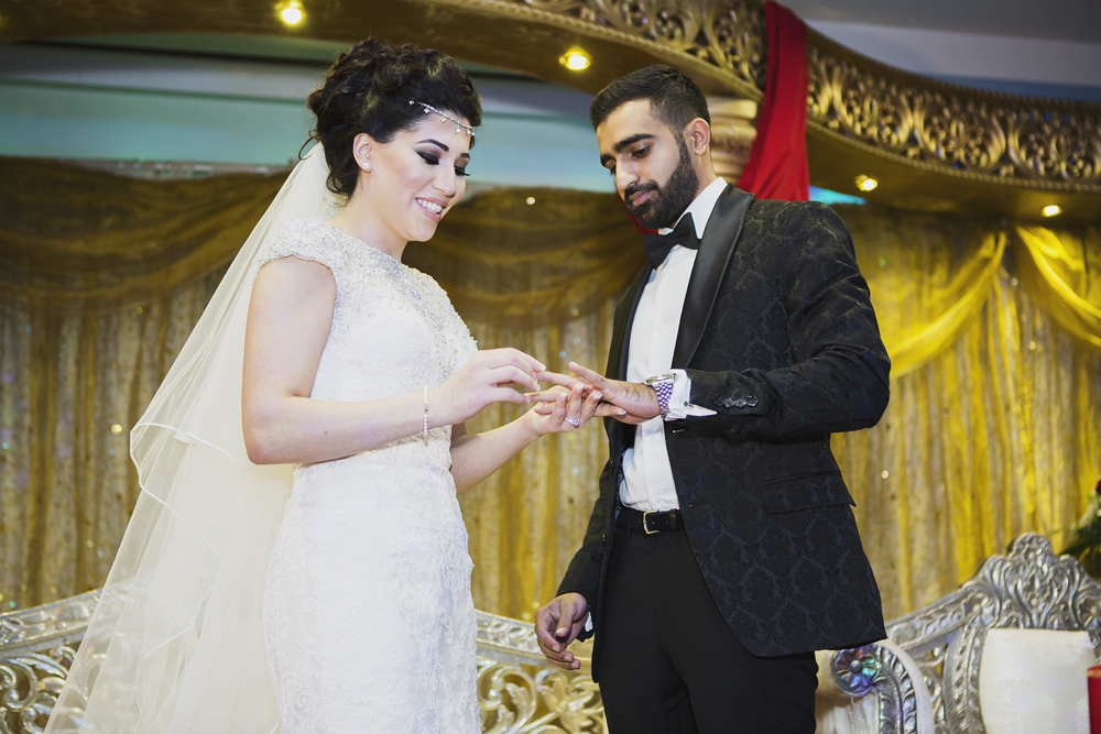ana gely photography female asian wedding photographer premier banqueting venue stage bride and groom rings