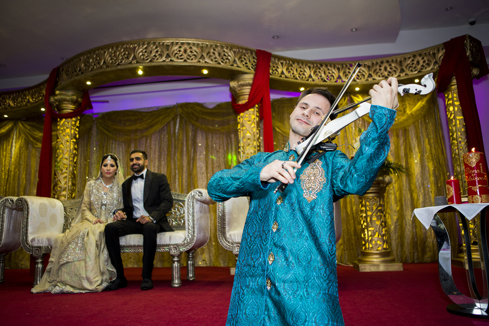 ana gely photography female asian wedding photographer premier banqueting venue stage bride and groom