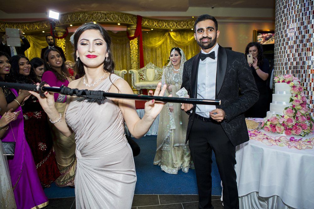 ana gely photography female asian wedding photographer premier banqueting afghan knife dance tradition cake