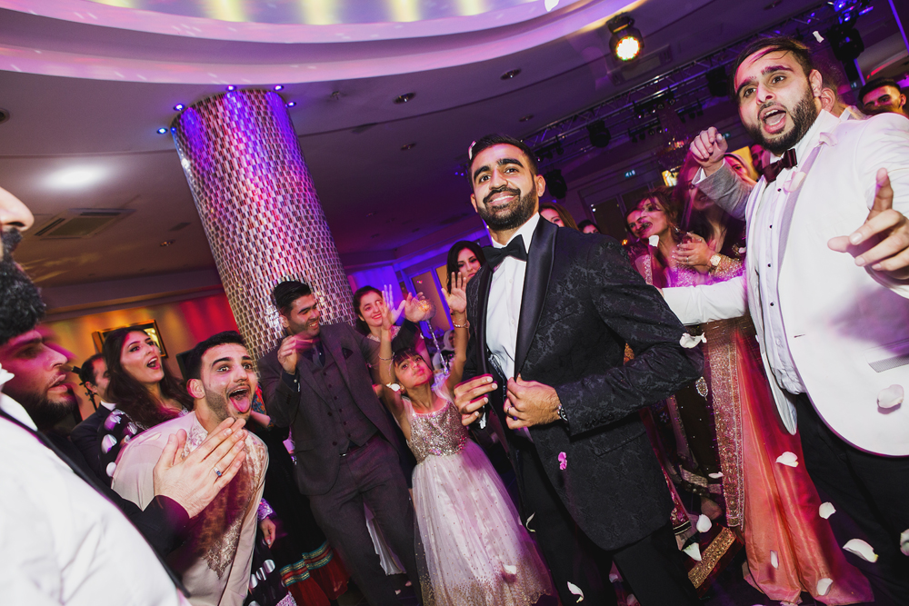 ana gely photography female asian wedding photographer premier banqueting party dancing groom