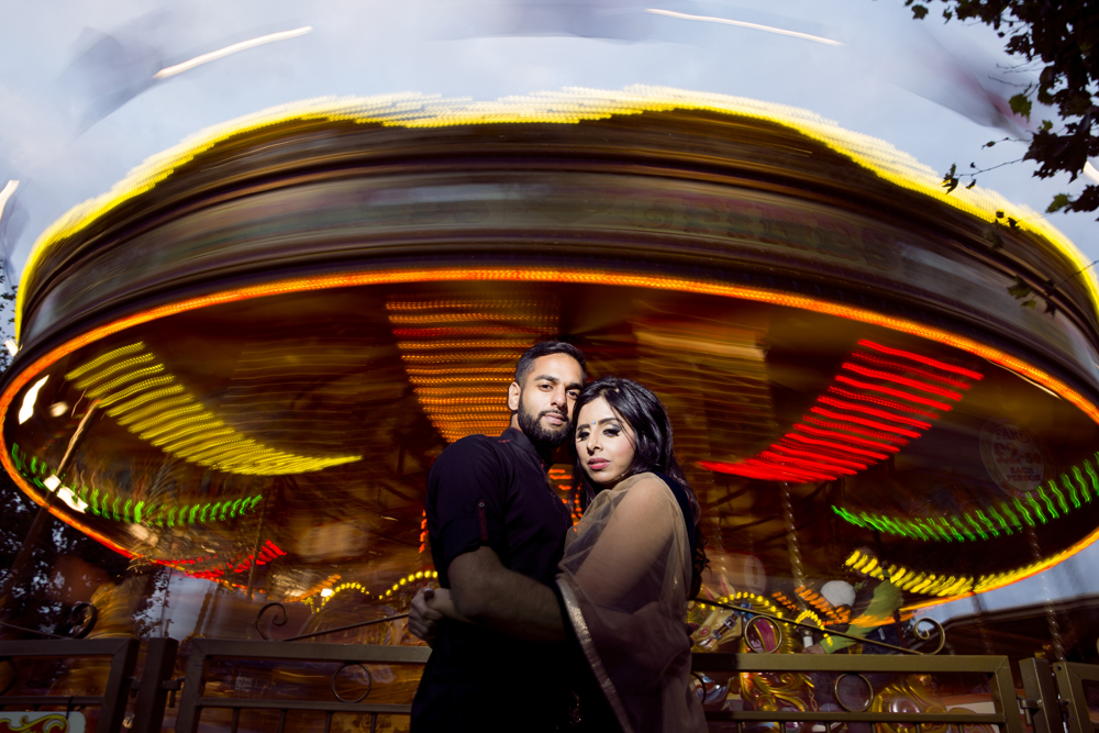 ana gely female asian wedding photographer engagement london city autumn indian bride and groom carousel