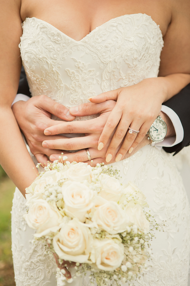 Ana Gely asian turkish wedding photographer London couple photos bride and groom autumn park hands together wedding rings white flowers