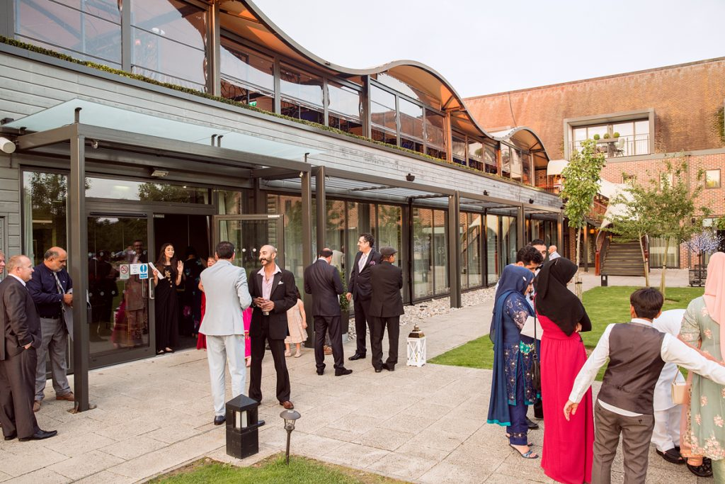 ana gely london female asian wedding photographer hilton syon park summer venue guests drinks