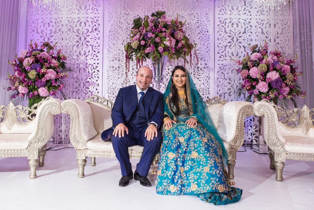 ana gely london female asian wedding photographer hilton syon park summer bride and groom stage