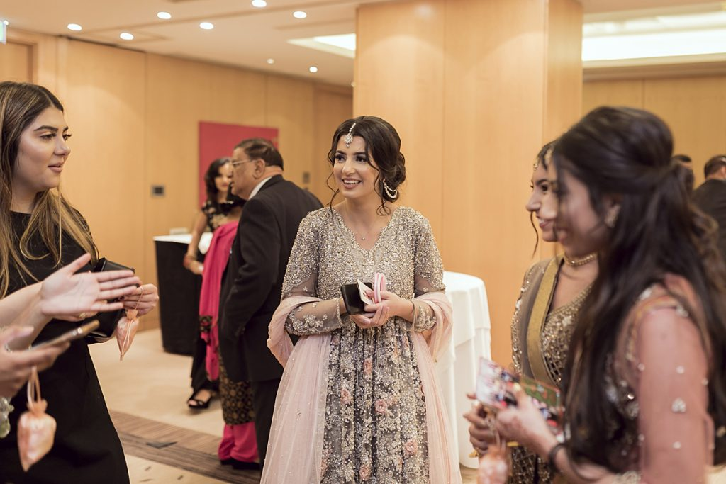 Ana Gely A photography London female asian wedding photographer Jumeirah Carlton drinks guests