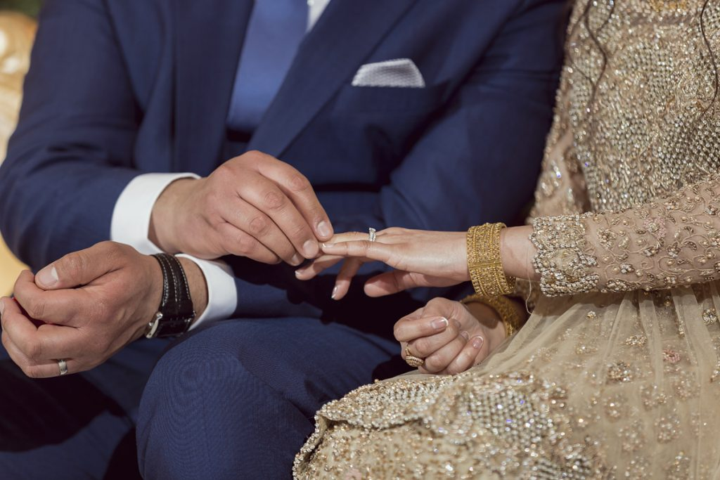 Ana Gely A photography London female asian wedding photographer Jumeirah Carlton bride and groom stage rings exchange
