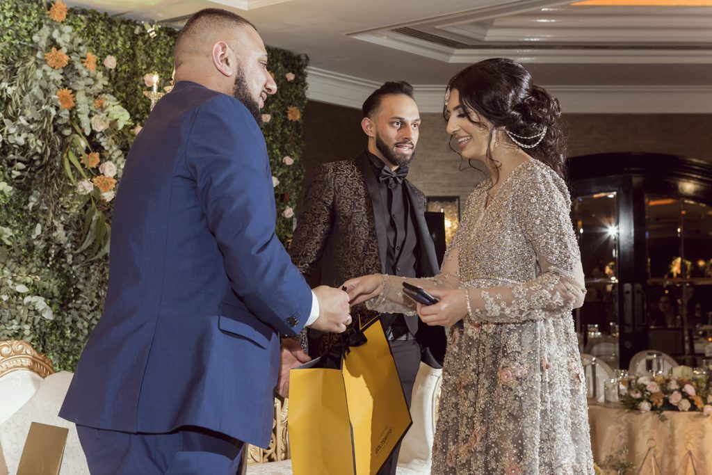 Ana Gely A photography London female asian wedding photographer Jumeirah Carlton bride and groom family photos stage gifts